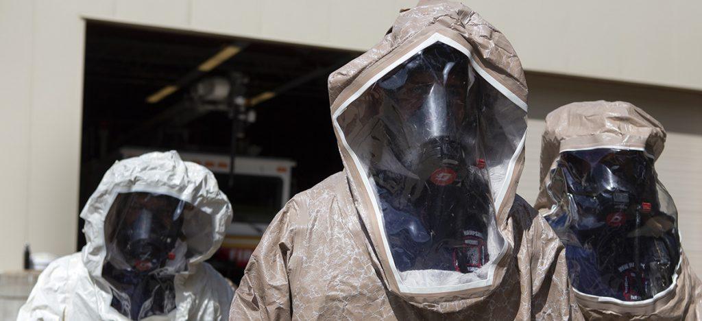Firefighters wearing hazardous materials personal protective equipment